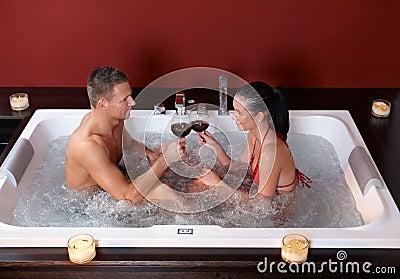 Couple celebrating in jacuzzi