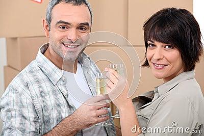 Couple celebrating on moving day
