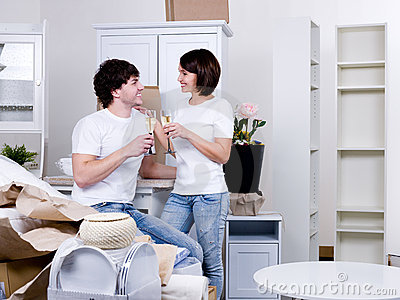 Couple celebrating new apartment