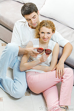 Couple celebrating with wine