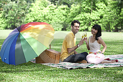 Couple with champagne glasses in the park
