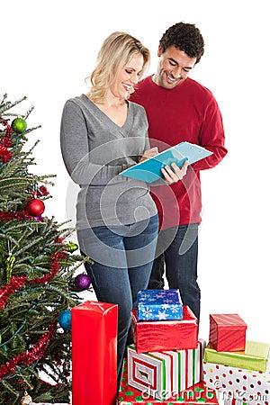 Couple checking Christmas list