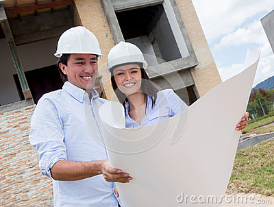 Couple checking their house project
