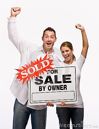 Couple cheering and holding for sale sign