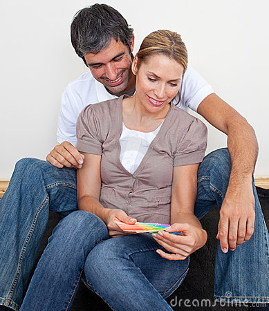 Couple choosing color to paint