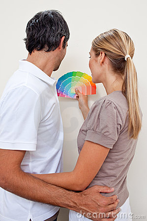 Couple choosing a color to paint their bedroom