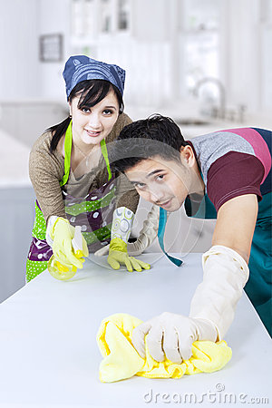 Couple cleaning new home