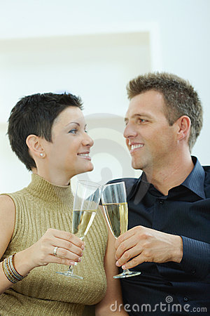Couple clinking with champagne