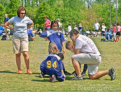 Couple Coaching Girls Soccer Editorial Photo
