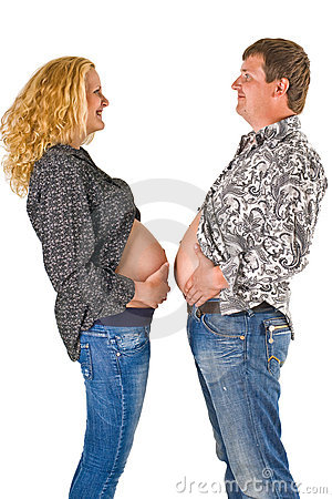 Couple comparing bellies