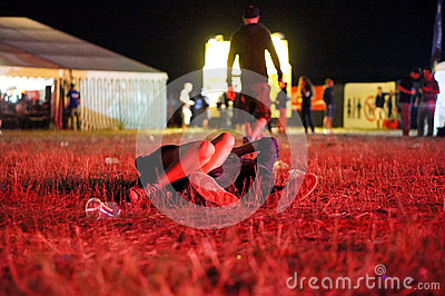 Couple after concert lying on the ground Editorial Stock Image