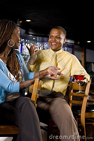 Couple conversing at a bar