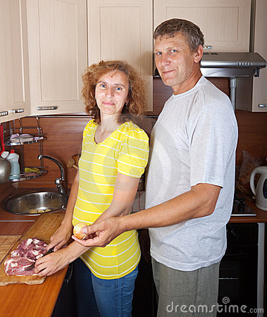 Couple  cooking meat