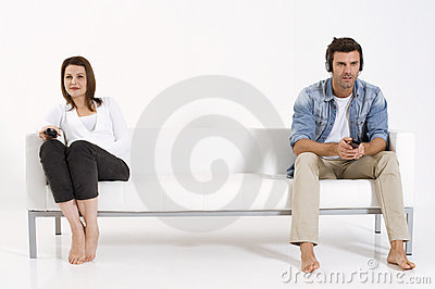 Couple on the couch watching TV