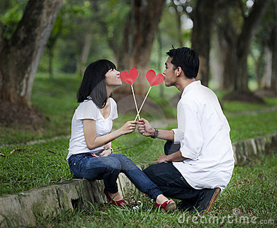 Couple with paper hearts