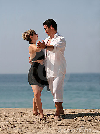 Couple dancing on the beach