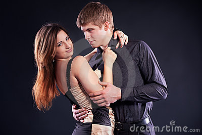 Couple dancing on a black background