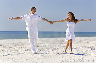Couple Dancing Holding Hands on A Tropical Beach