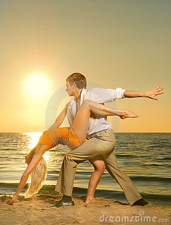 Couple dancing near the ocean