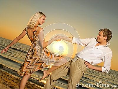 Couple dancing near the ocean