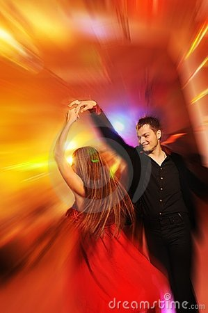 Couple dancing in the night club
