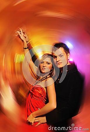 Couple dancing in the night club