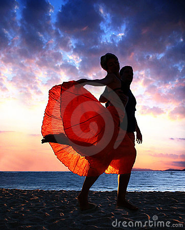 Couple dancing at sunset