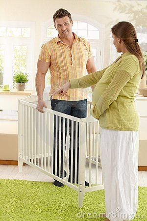Couple deciding on baby bed