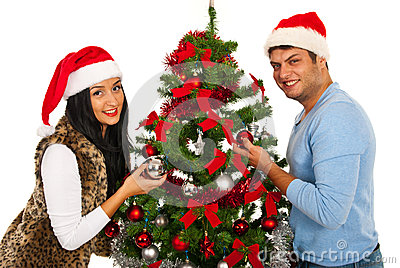 Couple decorate Christmas tree
