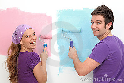 Couple decorating painting
