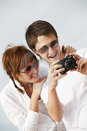 Couple with a digital camera