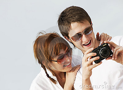 Couple With A Digital Camera Stock Photos - Image: 10944183