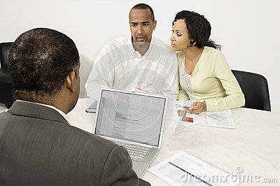 Couple Discussing Financial Plans With Male Advisor
