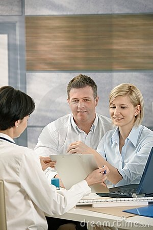 Couple discussing results with physician