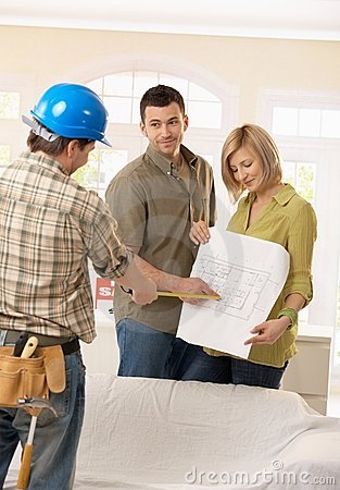 Couple in discussion with builder