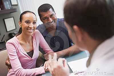 Couple in discussion with doctor in IVF clinic