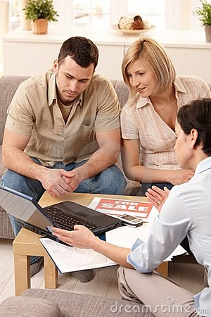 Couple in discussion with estate agent
