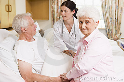 Couple doctor senior talking to