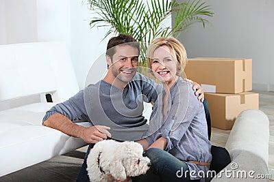 Couple and dog move into home