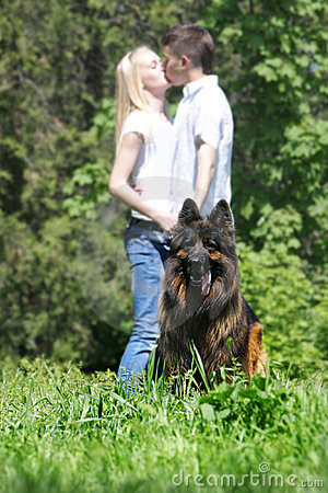 Couple with dog outdoors