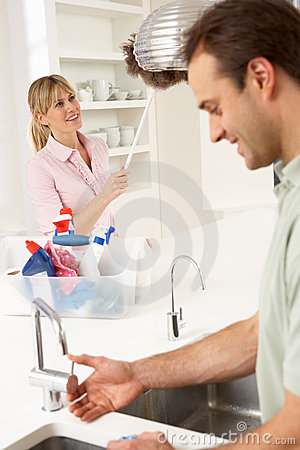 Couple Doing Housework In Kitchen Together