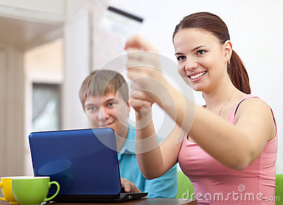 Couple doing shopping in internet with credit card