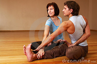 Couple doing yoga practice