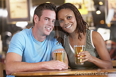Couple Drinking Beer In A Pub