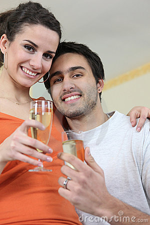 Couple drinking a celebratory drink