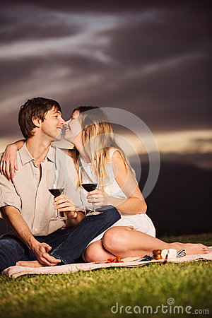 Free Couple Drinking Glass Of Wine On Romantic Sunset Picnic Royalty Free Stock Image - 36230036