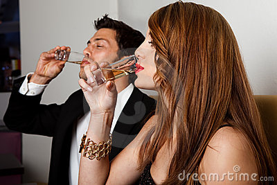 Couple drinking liquor shots
