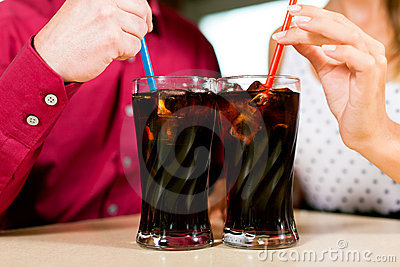 Couple drinking soda in a bar or restaurant