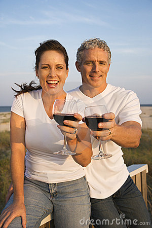 Free Couple Drinking Wine On Beach Stock Photography - 12666272