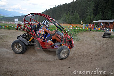 Couple driving Dune Buggy
